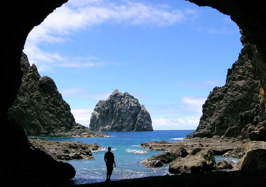 Black rock cave looking out to the sea surrounding St Helena