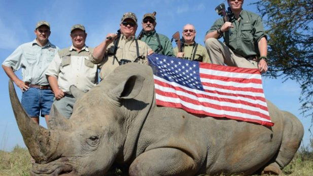 American trophy hunters photographed with their caught black rhino – via Fight for Rhinos