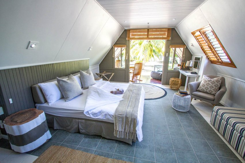 White- and grey-coloured bedroom interiors at Alphonse Island Resort – via AOS Fly Fishing