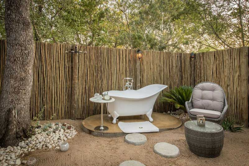 Indulgent outdoor bathroom at Tintswalo Manor House