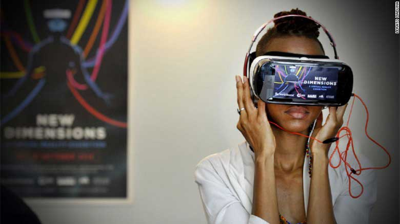 A woman tries a virtual reality headset at the African Futures Exhibition at the Goethe-Institut, Johannesburg.