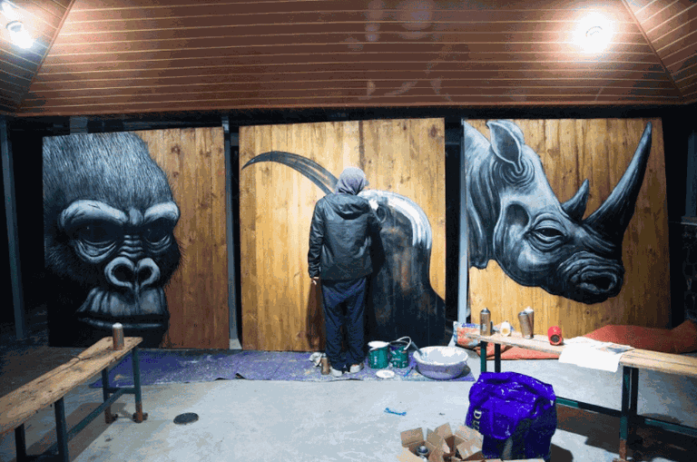 ROA paints at Volcanoes National Park Headquarters | Courtesy of Chris Schwagga / Kurema Kureba Kwiga, via Culture Trip